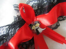 Handmade Red Wedding Garter Black Lace Red Ribbon with Bride and Groom Charm.