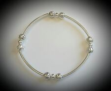 Silver plate beads bracelet with curved tube spacer & metal  filigree round ball