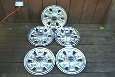 OE set of 4(plus spare) 67 Firebird/GTO 14 inch 3 bar spinner hubcaps,6 slot