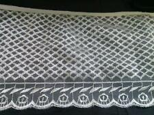 """1 yard off  white embroidered tulle with floral desgin. 59x7"""" 67x7"""" 53x7""""."""