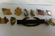 A selection of American military metal insignia and rank.