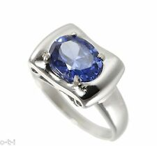 White Gold Finish Large Oval Cut Blue Sapphire Pedestal Sterling Silver Ring