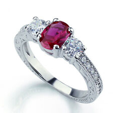 Women 7mm Rhodium Plated Sterling Silver Oval Ruby CZ 3 Stone Anniversary Ring