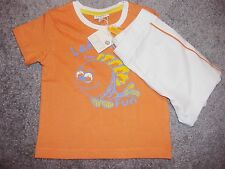 BABY BOYS 2 PIECE OUTFIT OF ORANGE T-SHIRT AND WHITE SHORTS AGE 3,6 AND 9 MTHS