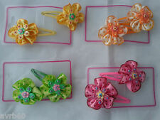 hair clips in a sleepies style with a frilly flower design for little girl new