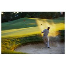 Poster Print Wall Art entitled Man hitting golf ball out of sand trap