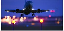 Poster Print Wall Art entitled an airplane landing with blurred lights of the
