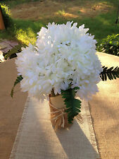 Wedding Table Centerpieces.  WhiteDahlias flower vase ready to place on tables.