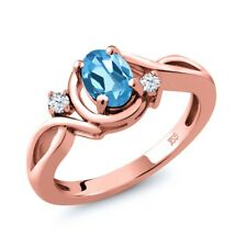 0.88 Ct Oval Swiss Blue Topaz White Topaz 18K Rose Gold Plated Silver Ring