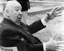 ALFRED HITCHCOCK SEATED IN HIS DIRECTOR'S CHAIR PHOTO OR POSTER