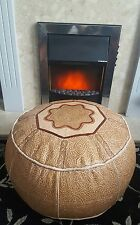 Moroccan leather pouffe with flower design, neutral tones,with green/red accents