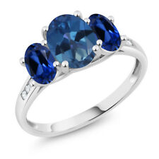 10K White Gold 2.30 Ct Blue Mystic Topaz Blue Simulated Sapphire 3-Stone Ring