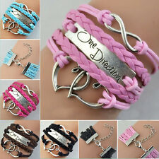 ONE DIRECTION SILVER COLOURED BRACELET AND LOVE HEART BRAIDED LEATHER WRISTBAND