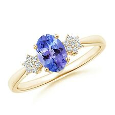 Tapered Oval Tanzanite Solitaire Ring with Diamond Clusters 14k Yellow Gold