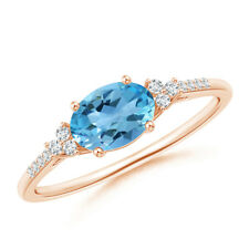 Horizontally Set Oval Swiss Blue Topaz Solitaire Ring with Diamond Accents Gold