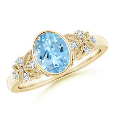 Oval Aquamarine Ring with Natural Diamond Accents 14K Yellow Gold