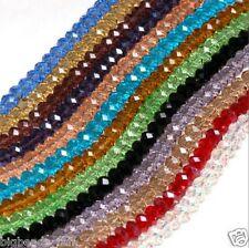 A string of flat round facted crystal rondelle beads  in various colours & sizes
