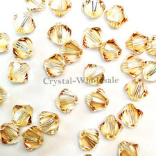 5mm Crystal Golden Shadow Genuine Swarovski crystal 5328 / 5301 Bicone Beads