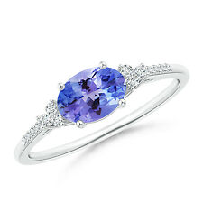 Oval Natural Tanzanite Solitaire Ring with Trio Diamond Accents Silver/ 14k Gold