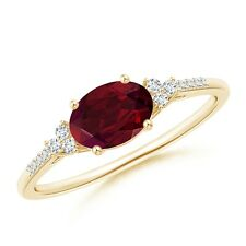Oval Garnet Solitaire Ring with Trio Diamond Accents 14k Yellow Gold/ 925 Silver