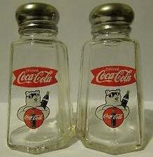 A Charming Coca Cola Fish Tail Salt and Pepper Shakers