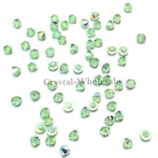 6mm Chrysolite AB (238 AB) Swarovski crystal 5328 / 5301 Bicone Beads