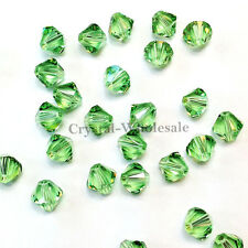 6mm Peridot (214) Genuine Swarovski crystal 5328 / 5301 Loose Bicone Beads
