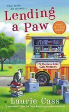 A Bookmobile Cat Mystery: Lending a Paw 1 by Laurie Cass (2013, Paperback)