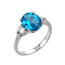 2.0 CTW Oval Blue Topaz Three Stone Engagement Ring in White Gold