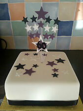 wired star birthday cake topper with numbers. various colours