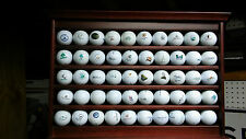 Cherry wood golf ball display rack with 50 country club and east coast courses