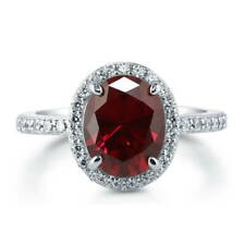 BERRICLE Sterling Silver Oval Cut Simulated Ruby CZ Halo Engagement Wedding Ring