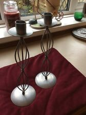 A PAIR OF SILVER CANDLE HOLDERS