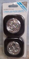 NIP Sontax 2 Pack LED Puck Light Black Batteries Included Stick On