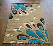 Yellow and teal area rug