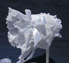 New White Cotton with Wide Lace and White Satin Bows and Flowers Baby Bonnet