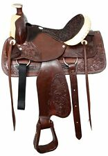 """16""""Semi acorn tooled Buffalo roper style saddle with rawhide silver laced cantle"""