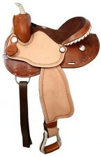 Double T barrel saddle,silver laced rawhide cantle, roughout fenders and jockies