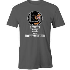 Love is being owned by a Rottweiler T-Shirt dogs Animal