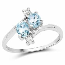Genuine Oval Blue Topaz and White Topaz Ring in Sterling Silver