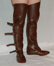 Medieval leather riding boots with brass buckles in black and brown leather, UK