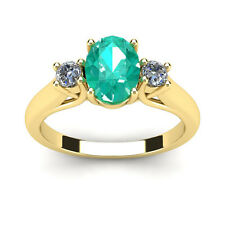 14K YELLOW GOLD 1 CARAT OVAL SHAPE EMERALD AND TWO DIAMOND RING