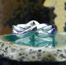 4 piece Sterling Silver Puzzle Ring in sizes 6, 7, 8, 9, 11, 12