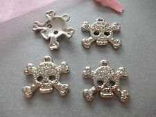 4 X CLEAR CRYSTAL SKULL & CROSSBONES PENDANTS/CHARMS ,GOOD FOR JEWELLERY MAKING