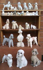 SELECTION OF POODLE DOG FIGURINES.