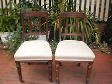 PAIR OF ANTIQUE / VINTAGE SOLID HARDWOOD  TIMBER CHAIRS WITH CASTOR WHEEL.