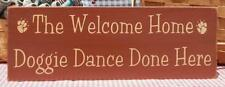 The Welcome Home Doggie Dance Done Here painted primitive wood sign