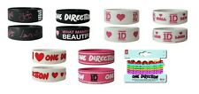< ONE DIRECTION - OFFICIAL RUBBER WRISTBAND - different designs and logo