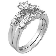 Sterling Silver Round Cz Wedding Ring Set with a 5MM Round Cz in the Center 104