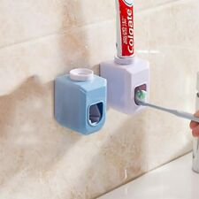 Define dispense Hands Free Automatic Squeezer Toothpaste Dispenser  Squeeze Out